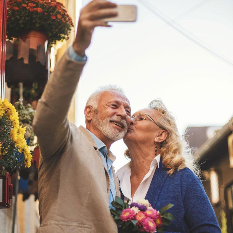 Senior man and woman take selfie