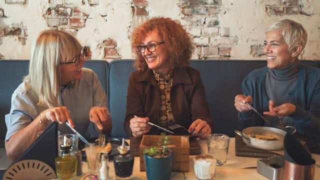 Women enjoying fondu.