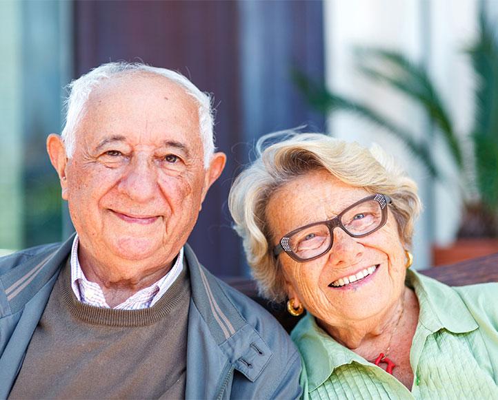 A senior couple smiles