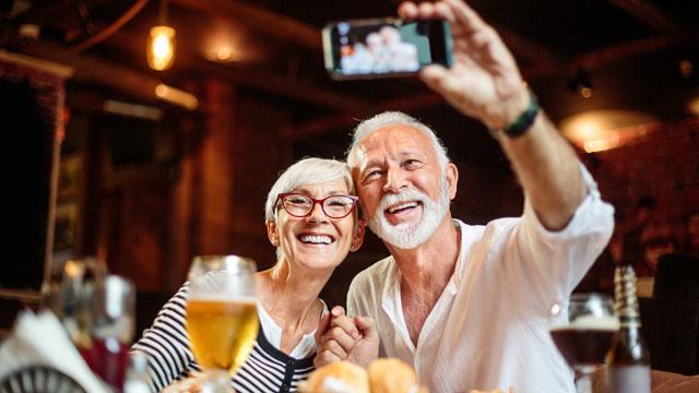A senior couple taking a selfi photo