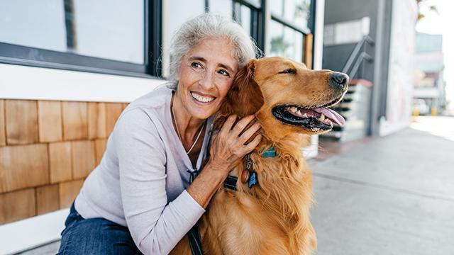 Senior Hugging Dog