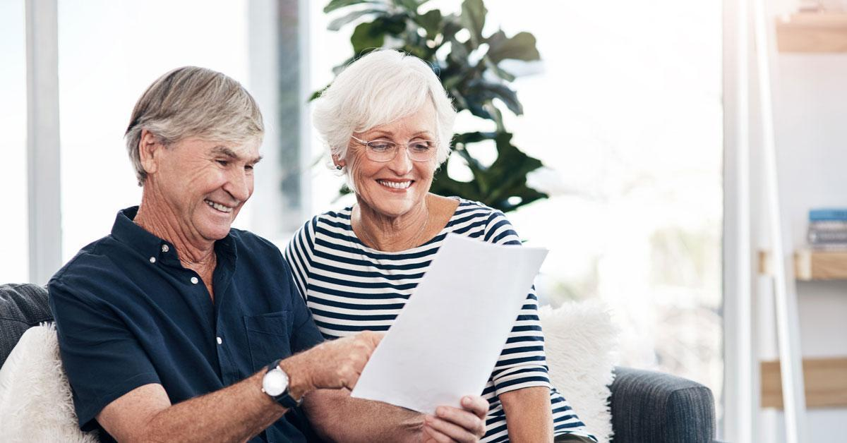 A senior couple reviewing paperwork.