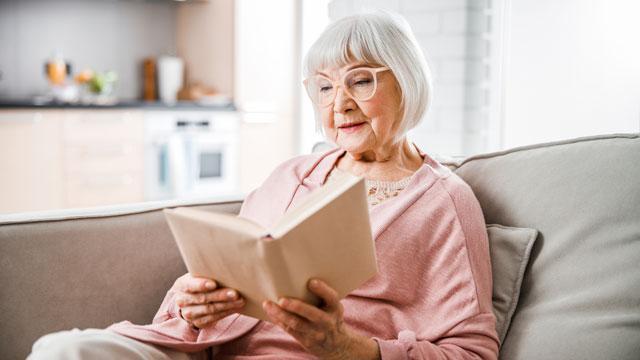 A women reading a book at Hidden Springs of McKinney