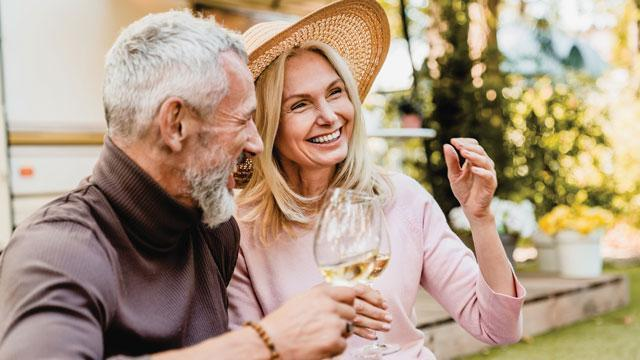 A couple enjoying a glass of white wine at Hidden Springs of McKinney