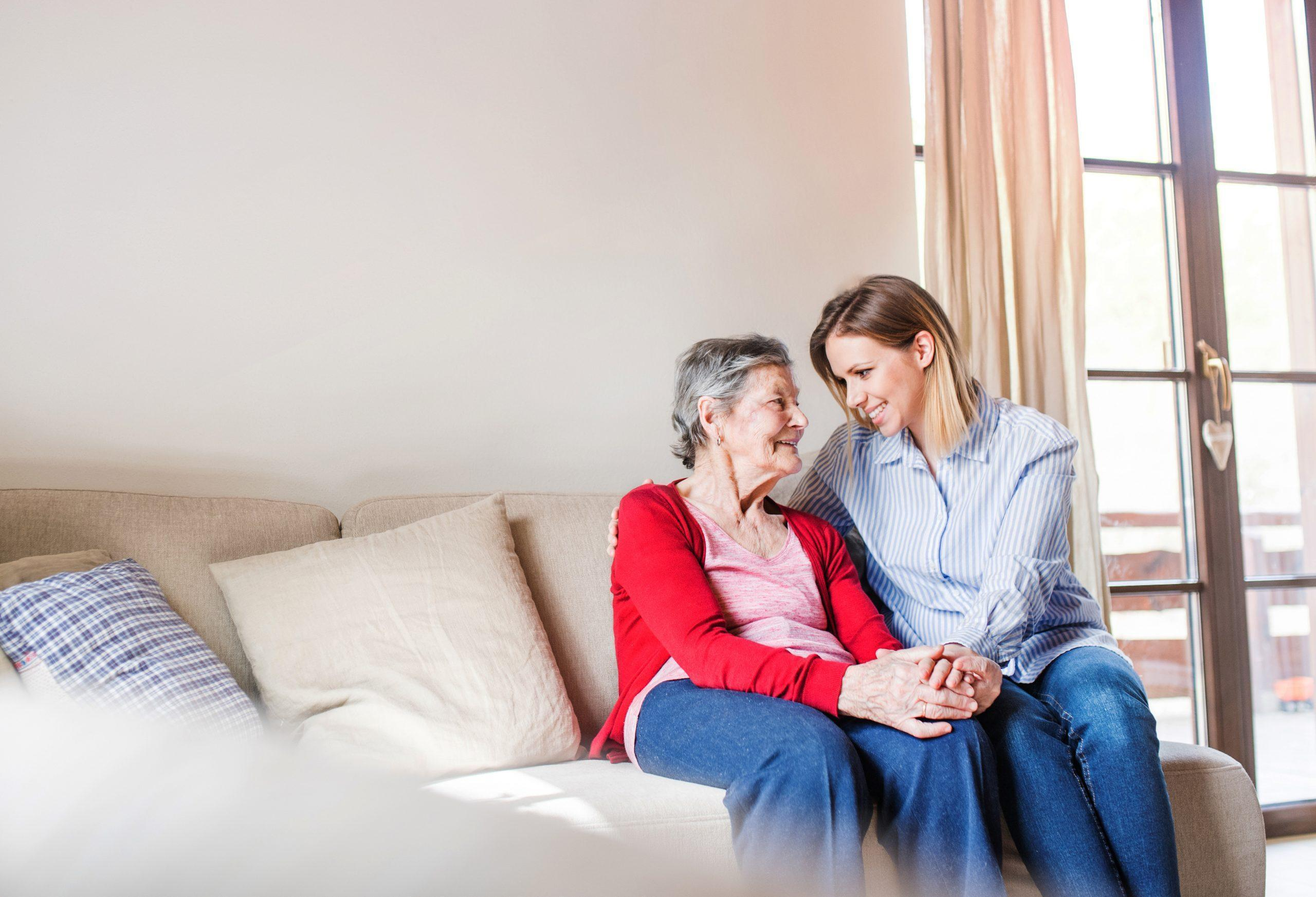 An elderly grandmother with an adult granddaughter at home.
